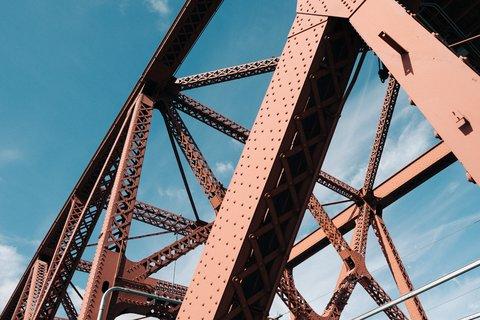 Ryan Bruce_main picture_ metal-bridge-beams-with-blue-sky